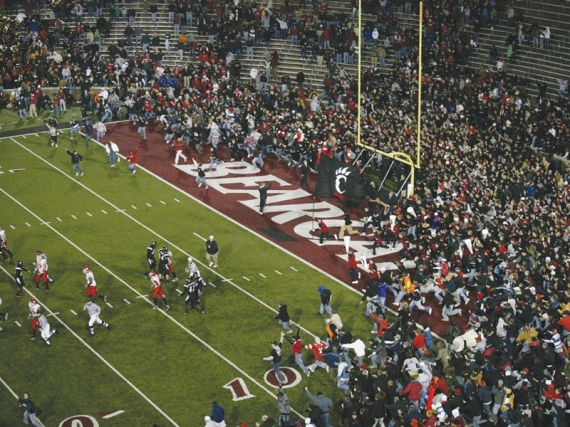 Bearcat fans storm the field