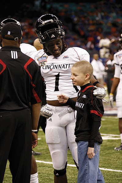 Mitch bonds with his favorite player Mardy Gilyard prior to the Sugar Bowl. Photo/Ashley Kempher