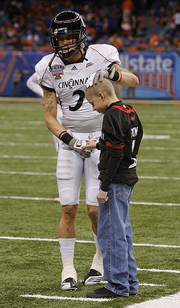 Wide receiver D.J. Woods gives Mitch Stone some love during warm-ups. Photo/Lisa Ventre
