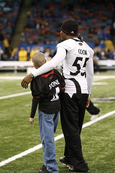 Mitch hangs out with Austin Cook during pregame in the Super Dome. Photo/Lisa Ventre