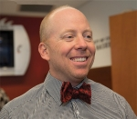 University of Cincinnati basketball coach Mick Cronin sports the new UC bowtie design.