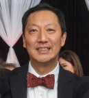 University of Cincinnati president Santa Ono sports the new UC bowtie design.