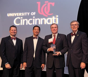 A photo of four important figures at the University of Cincinnati, Rodney Grabowski, Santa Ono, Phil Collins and Robert Fealy.