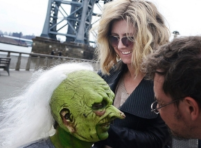 "University of Cincinnati alum Cara Sullivan is shown working on the crazy white hair of an actor in costume for the television show ""Saturday Night Live."""