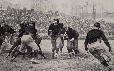 A vintage photo of a University of Cincinnati football game that features the namesake of UC's mascot, Teddy Baehr.