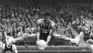 A photo of University of Cincinnati basketball great Oscar Robertson in his signature wide-leg stance.