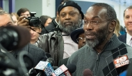 A man, Ricky Jackson, is surrounded by media microphones upon his release from prison after 39 years of wrongful incarceration. The University of Cincinnati-based Innocence Project aided in his release.