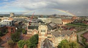 A beautiful rainbow crosses over the University of Cincinnati campus.