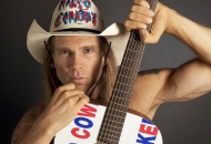 A photo of a man with a cowboy hat and holding up a guitar is University of Cincinnati alum Robert Burck, better known as the Naked Cowboy.