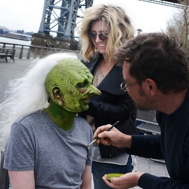 "University of Cincinnati alumna and Emmy-winning hairstylist and wig designer Cara Sullivan works on a ""monsters"" white wig on the set of Saturday Night Live."