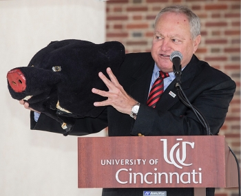 University of Cincinnati alumnus Tom Humes shows off his memento, the large head of his Bearcat costume.