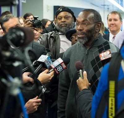 Ricky Jackson is surrounded by media microphones after his exoneration from prison after 39 years.
