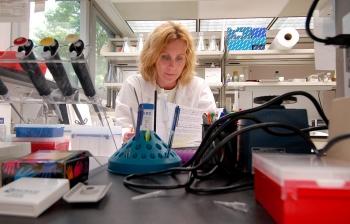 Kidney cancer researcher Maria Czyzyk-Krzeska hard at work in her laboratory.