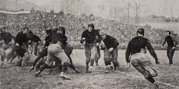 Teddy Baehr carries the ball in 1914. Image from 1915 Cincinnatian