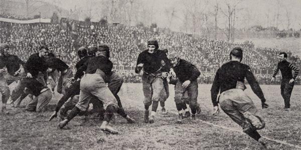Teddy Baehr carries the ball in 1914. Image from 1915 Cincinnatian