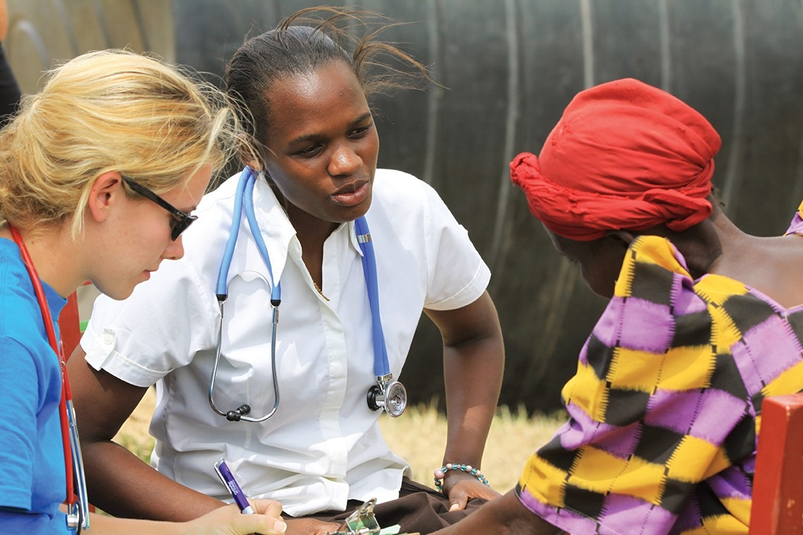 Maria Nakafeero speaks to a patient in Uganda