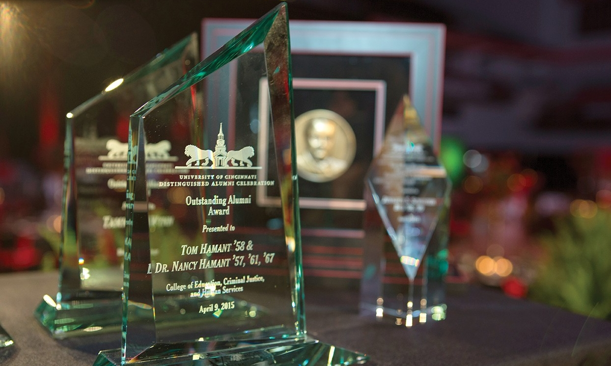 A table of glass awards from Distinguished Alumni celebration event