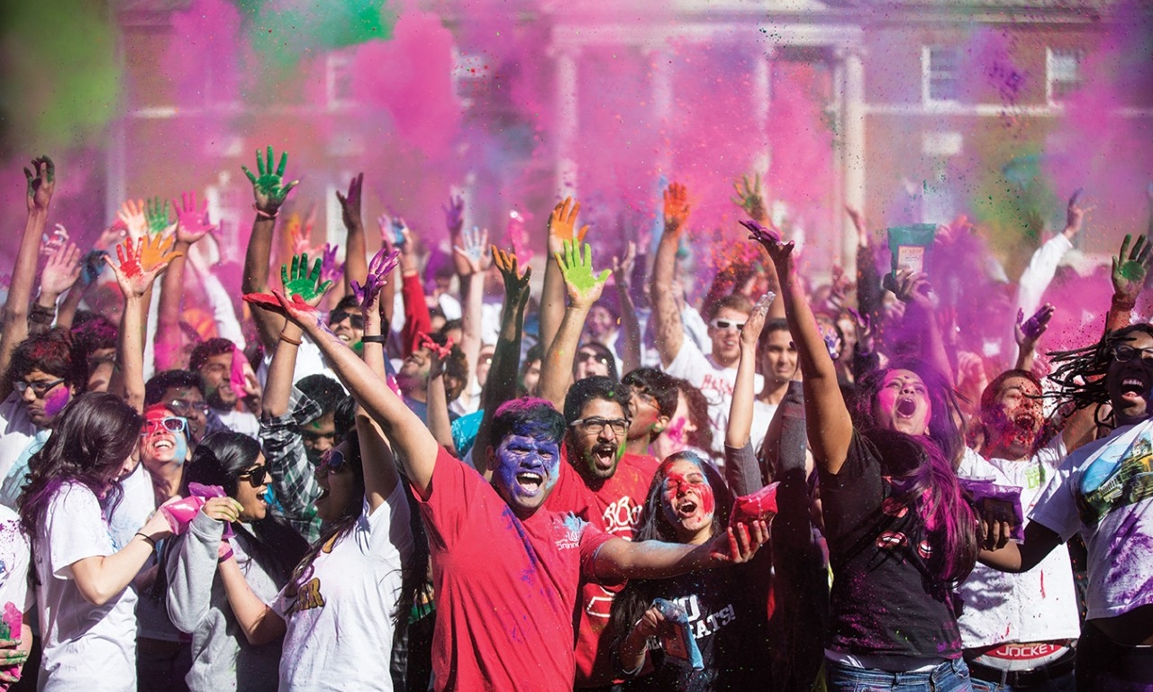 UC students celebrate as part of Holi festival by throwing colored powders