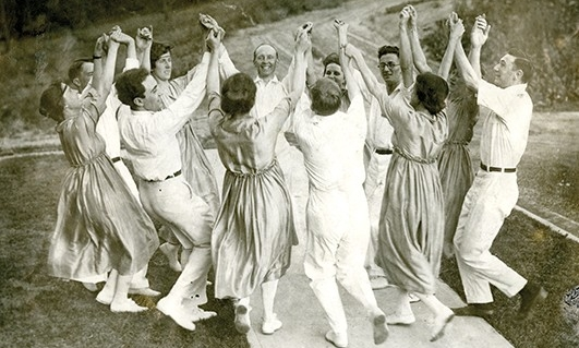 Group from 1916 takes part in folk dance outside