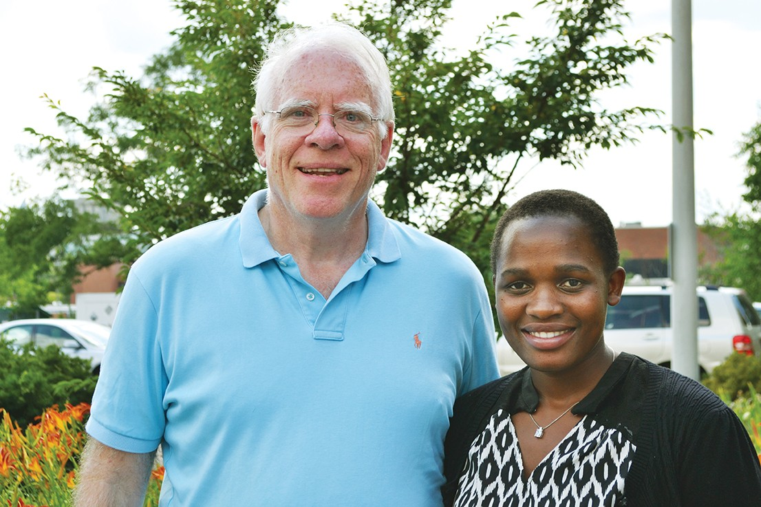 James O'Reill stands next to Maria Nakafeero.