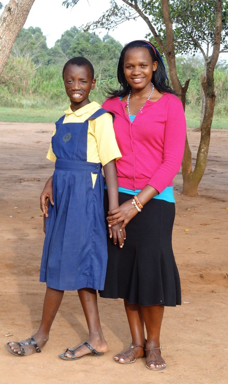 Maria Nakafeero stands with Mackline Tumusiime, a teenager from Uganda who came to Shriners Hospitals for Children to have reconstructive surgeries.