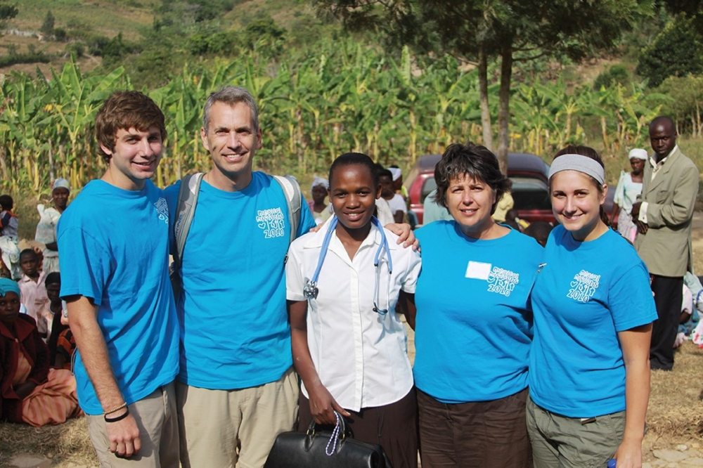 Maria Nakafeero spends time with volunteers from a medical mission trip in Kabingo, a small village in western Uganda.
