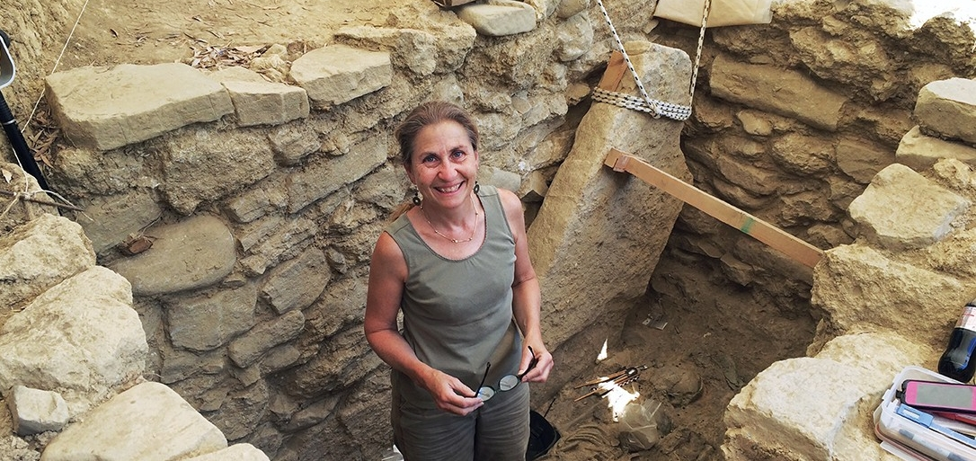Sharon Stocker stands inside a warrior's tomb in Greece