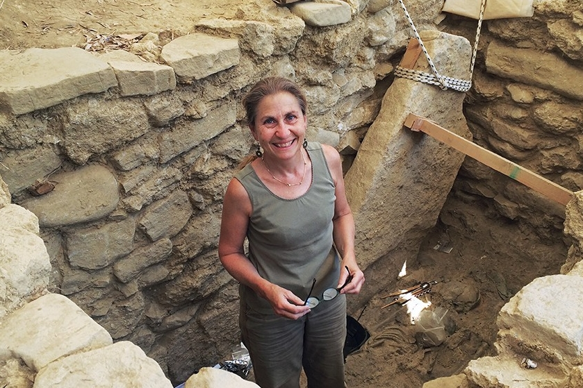 Archaeologist Sharon Stocker stands inside a tomb in Greece