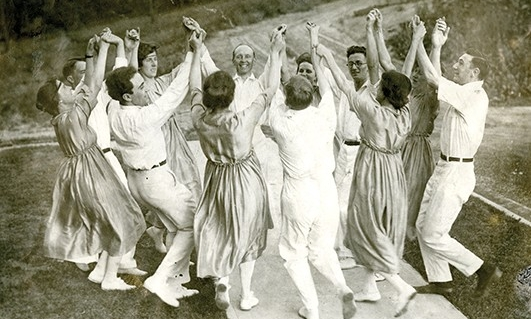 A group of people dance at 1916 event