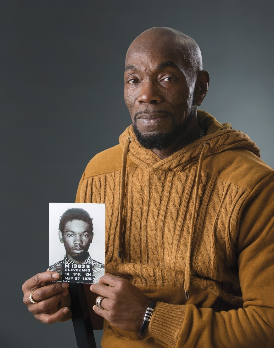 Ricky Jackson holds his mugshot from 1975