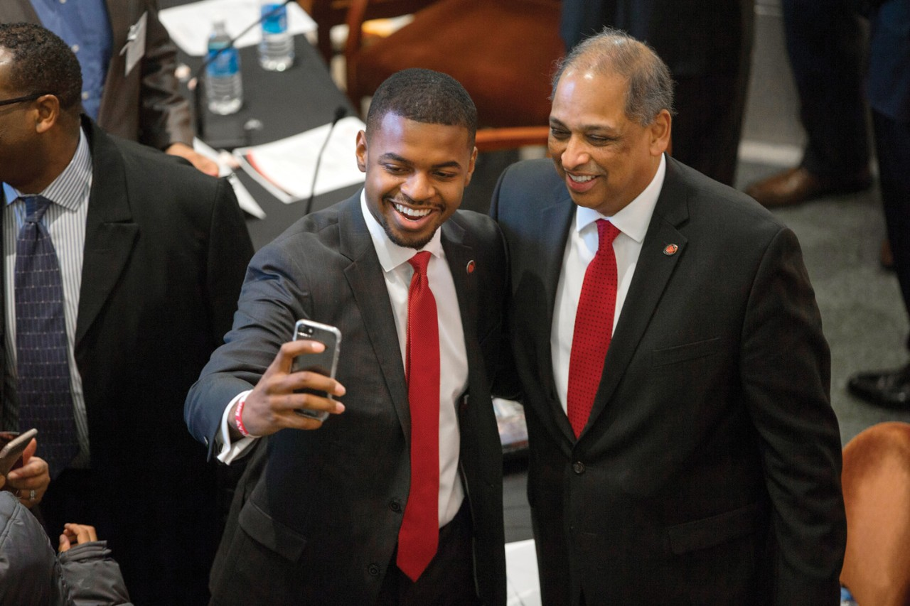 Student Government President Mitchell Phelps grabs a selfie with President Neville Pinto.