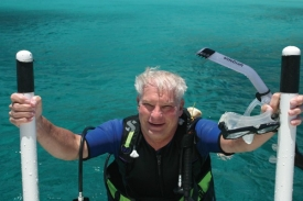 Professor David Meyer emerging from a dive in Curaçao.
