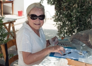 Gisela Walberg catalogs shards under an Olive tree.