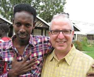 Drama professor Richard Hess led a contingent of students to Kenya last summer where they met refugees such as Abdi Rashid, a writer, who translated Hess' words to Somali.