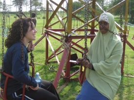 UC student Alyssa Caputo, then a freshman, bonds with Sumayo, a 16-year-old Somali refugee from Dadaab. photo/Richard Hess