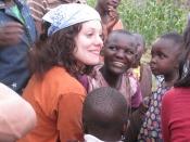 UC student Alyssa Caputo sits among children from the slums of Kengemi. photo/Richard Hess