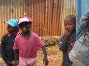 Youngsters from Kangemi investigate their American visitors.