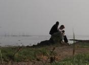 UC student Will Kiley and Ojullu, an Ethiopian refugee, write poetry together next to Lake Naivasha photo/David Felix Sutcliffe
