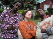Bearcat Alyssa Caputo gives refugees Abdi Rashid and Molid Iftin Mujale a few pointers on how to swag walk.
