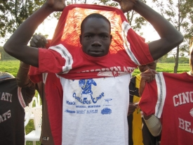 Ojullu Opiew Ochan pulls on a cherished Bearcats T-shirt gifted by Richard Hess and students when they arrived in Africa. Some of the refugees barely took off the shirts during the week. photo/Richard Hess