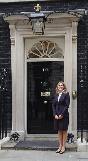 Robin Engel, in front of 10 Downing St., prepares to meet British Prime Minister David Cameron.