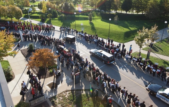 The Lindner procession winds through campus.