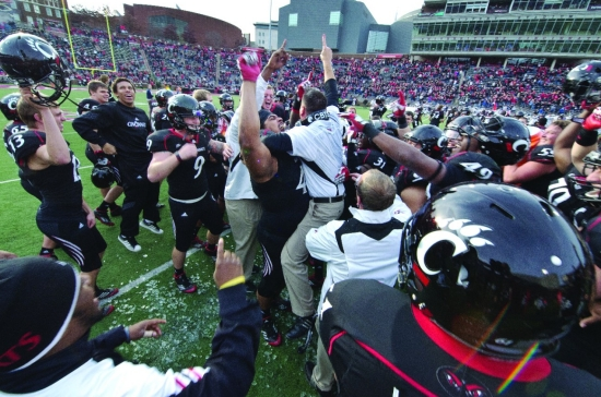 Bearcats celebrate their Big East championship on the field.