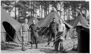 "In June 1944, these doctors -- Edward ""Red"" Elsey, Dudley ""Doug"" Wolfe, Max Haas and James ""Jimmy"" Mack (in unknown order) -- waited in North Tidworth, England, to be transferred to Europe after D-Day.   Setting up 529 tents on concrete bases to form a hospital in Lison, France, became difficult in August 1944 when continual rain created so much mud that trucks became trapped."