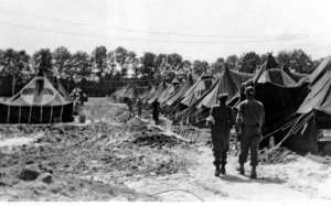 Setting up 529 tents on concrete bases to form a hospital in Lison, France, became difficult in August 1944 when continual rain created so much mud that trucks became trapped.