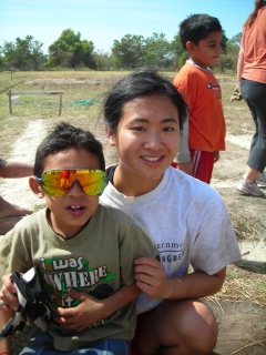 Allison Ng with a child in El Salvador