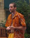 Trnt oveerseas wearing a tropical print button-up shirt.