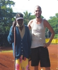 Tony Frasier standing next to an elderly resident of the village at which he serves.