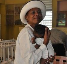 Pamela Bridgewater cuddles Jamaican infant