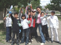 Michelle Bova in school yard where Eco-Club children (graded 5-8) were planting and cleaning up.